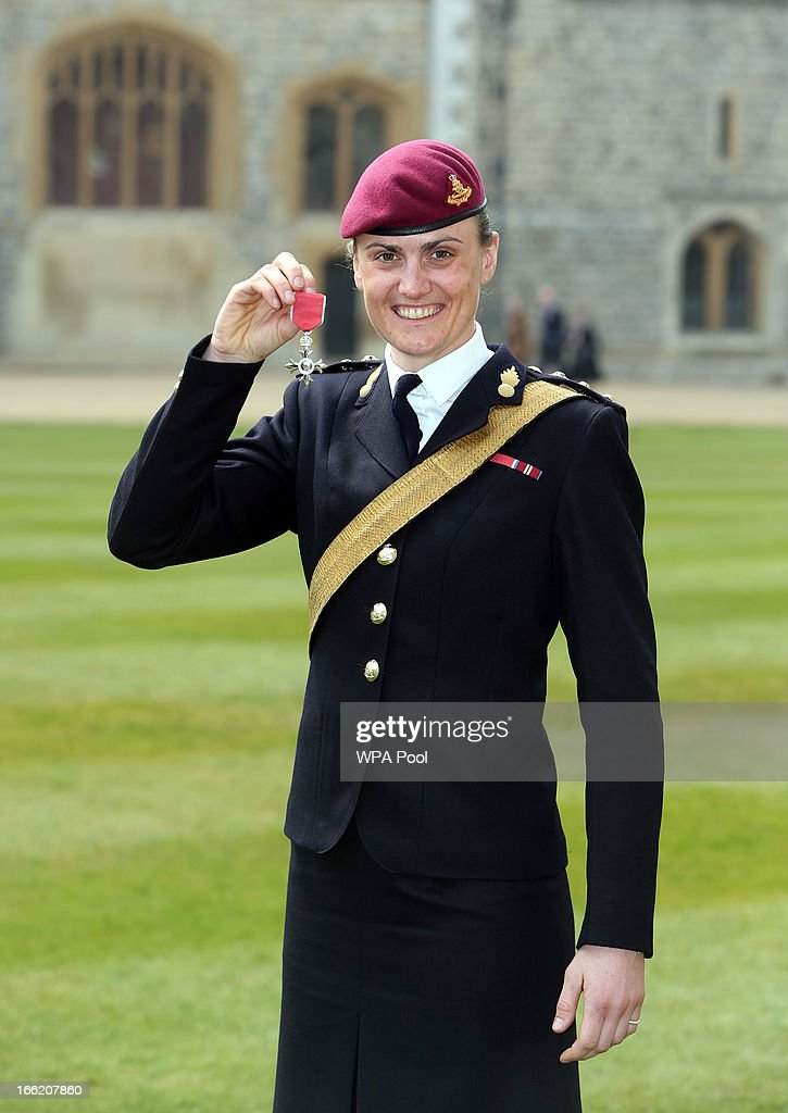 Team GB rower Captain <a gi-track='captionPersonalityLinkClicked' href=/galleries/search?phrase=Heather+Stanning&family=editorial&specificpeople=4436594 ng-click='$event.stopPropagation()'>Heather Stanning</a> poses with her MBE after an Investiture ceremony at Windsor Castle on April 10, 2013 in Windsor, England.