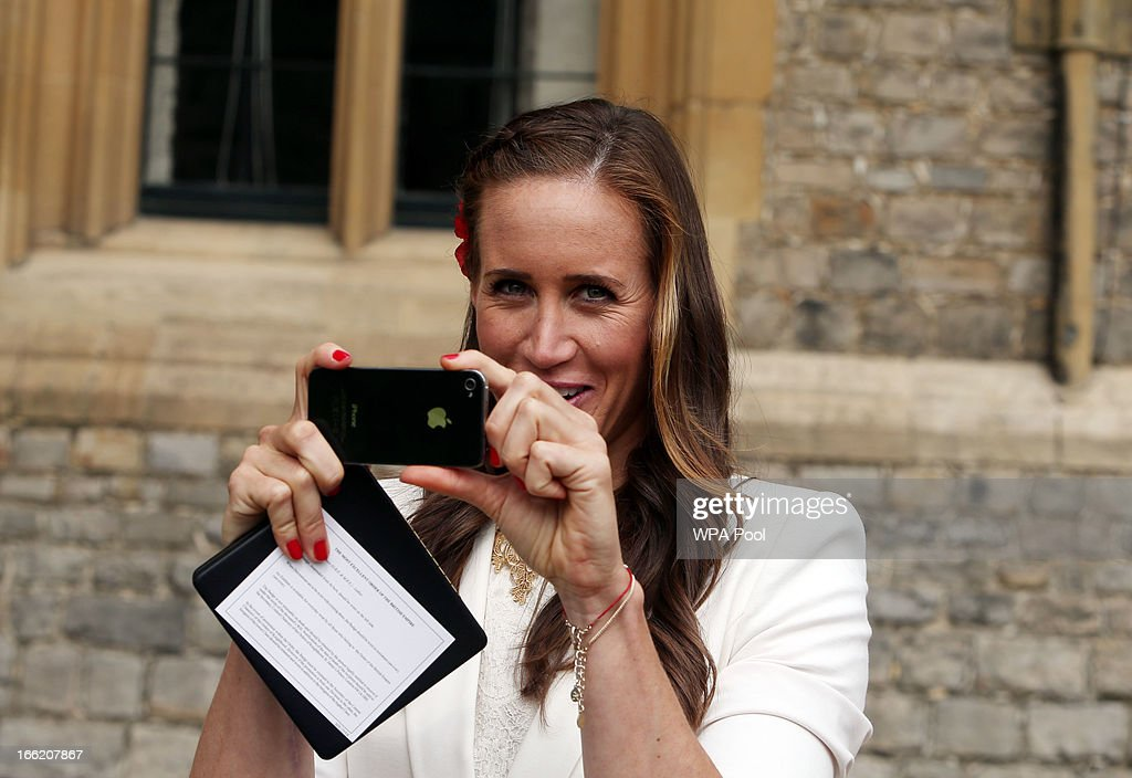 Team GB rower <a gi-track='captionPersonalityLinkClicked' href=/galleries/search?phrase=Helen+Glover+-+Rower&family=editorial&specificpeople=9609614 ng-click='$event.stopPropagation()'>Helen Glover</a> takes a photograph of her team mate Captain Heather Stanning (not pictured) after they both received MBE's at an Investiture ceremony at Windsor Castle on April 10, 2013 in Windsor, England.