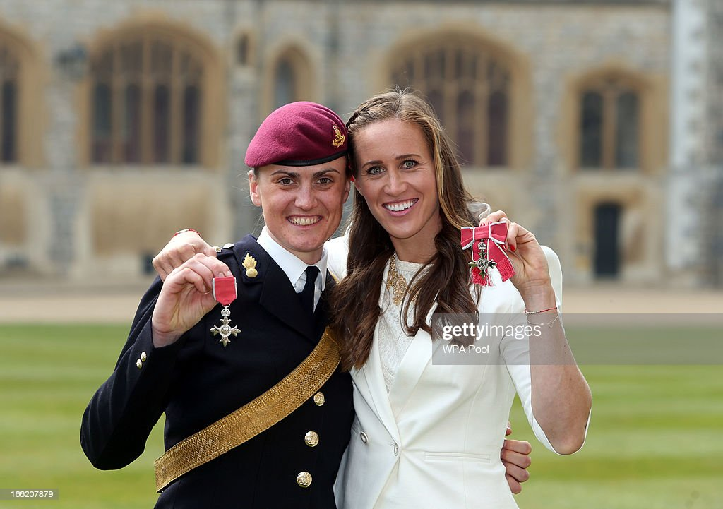 Team GB rowers Helen Glover (R) and Captain <a gi-track='captionPersonalityLinkClicked' href=/galleries/search?phrase=Heather+Stanning&family=editorial&specificpeople=4436594 ng-click='$event.stopPropagation()'>Heather Stanning</a> (L) pose after they both received MBE's at an Investiture ceremony at Windsor Castle on April 10, 2013 in Windsor, England.