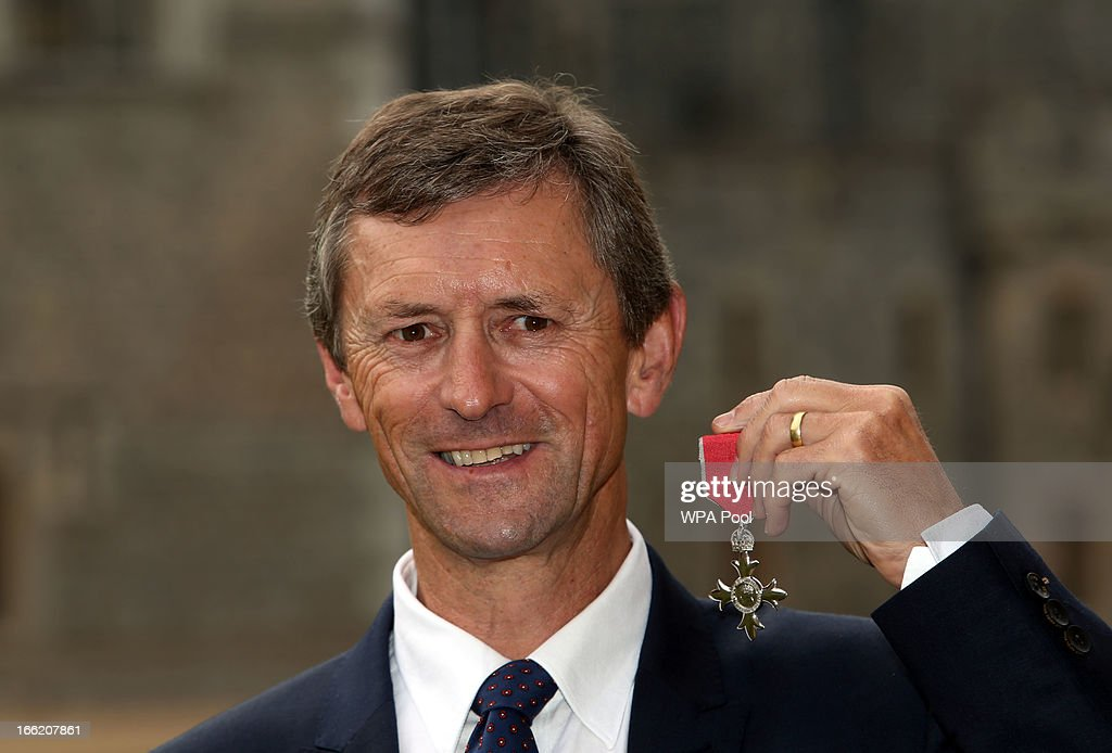 Team GB rowing coach Robin Williams poses with his MBE after an Investiture ceremony at Windsor Castle on April 10, 2013 in Windsor, England.