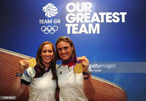 Team GB Rowing Gold medalists Helen Glover and Heather Stanning pose with their Gold Medals at GB House in Stratford on August 1 2012 in London...