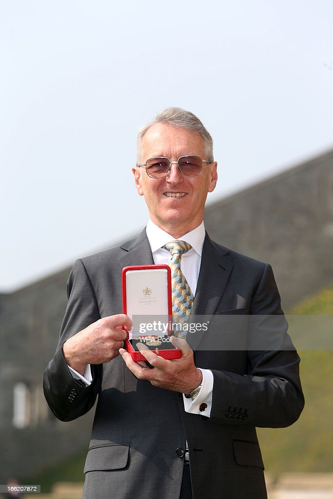 Team GB rowing head coach David Tanner poses with his Knighthood after an Investiture ceremony at Windsor Castle on April 10, 2013 in Windsor, England.