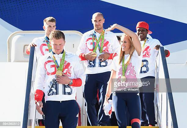 Team GB Swimmer and gold medallist Adam Peaty leaves the aeroplane with fellow gold medallist and rower Helen Glover after arriving home at Heathrow...