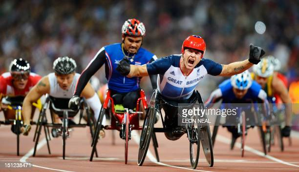 Team GB's David Weir celebrates after winning the gold medal in the men's 1500m T54 final at the Paralympic Games at the Olympic Park in east London...