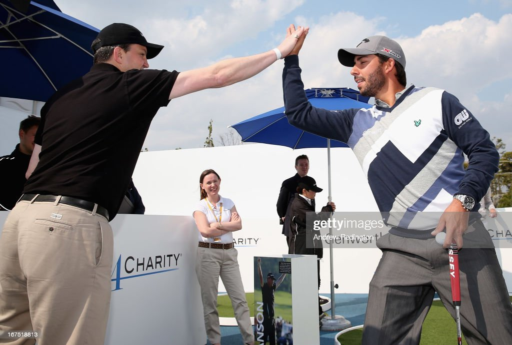 Team Genworth members Robin Hyndley (Global Reinsurance Director Genworth) and Pablo Larrazabal celebrate their victory in the Genworth Putts4Charity Challenge Series at the Ballantine's Championship at Blackstone Golf Club on April 26, 2013 in Icheon, South Korea.