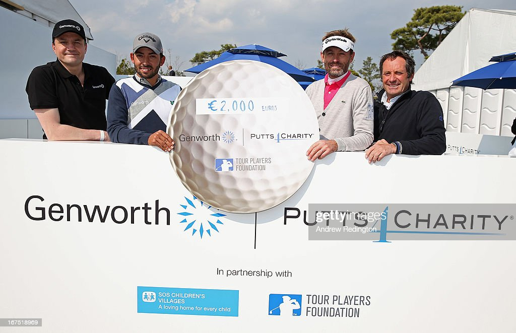 Team Genworth members Robin Hyndley (Global Reinsurance Director Genworth) and Pablo Larrazabal pose with the cheque alongside Raphael Jacquelin and David Williams of Team TPF following the Genworth Putts4Charity Challenge Series at the Ballantine's Championship at Blackstone Golf Club on April 26, 2013 in Icheon, South Korea.