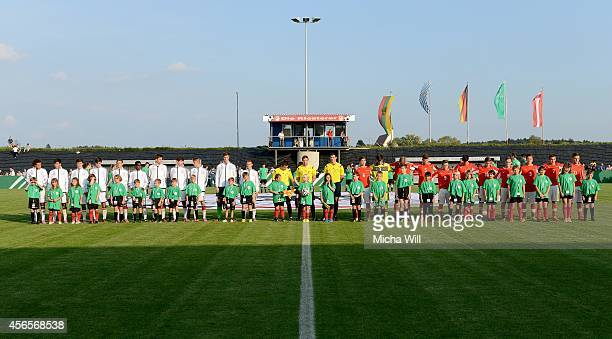 Team Germany and team Austria line up for the national anthems during the international friendly match between Germany U16 and Austria U16 at MAR...