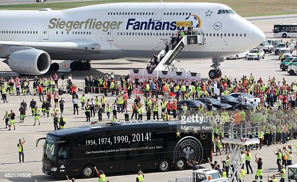Team Germany arrives at Berlin after winning the 2014 FIFA World Cup Brazil final against Argentina at Tegel Airport on July 15 2014 in Berlin Germany