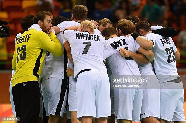 Team Germany celebrate their victory after the Men's Quarterfinal Handball contest against Qatar at Future Arena on Day 12 of the Rio 2016 Olympic...