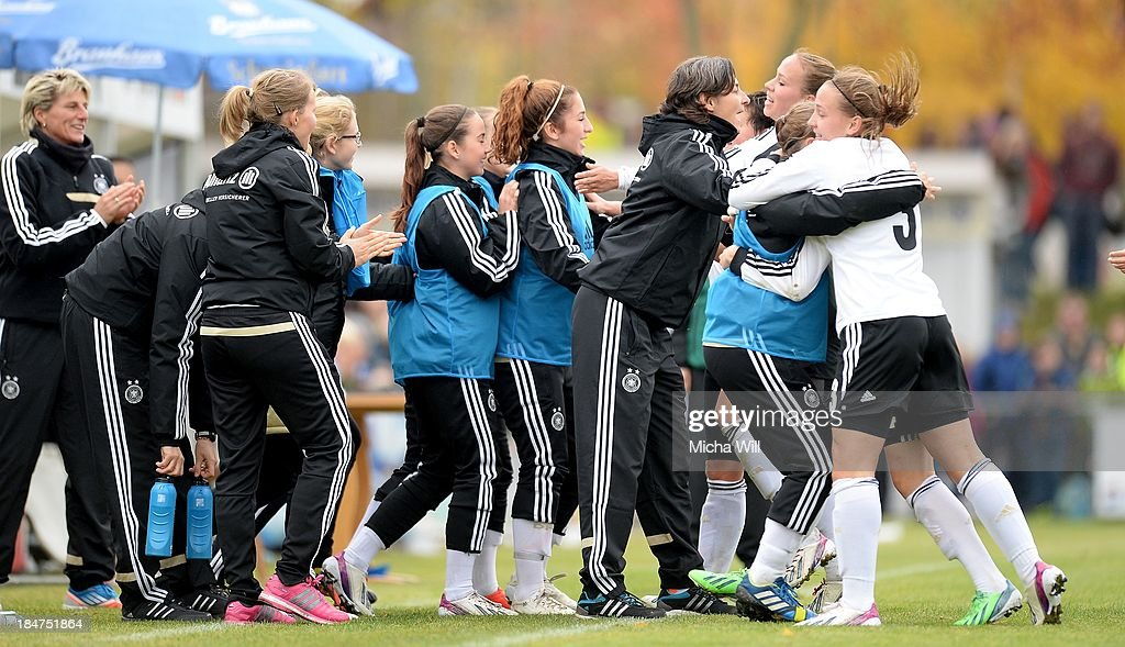 Team Germany celebrates the opening goal scored by Jasmin Sehan during the U17 Girls Euro Qualifier match between Germany and Belgium at Bioenergie-Arena on October 16, 2013 in Grossbardorf, Germany.