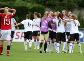 Team Germany celebrates the victory after the Women's U17 European Championship Semi Final between Denmark and Germany at the Colovray Stadium on...
