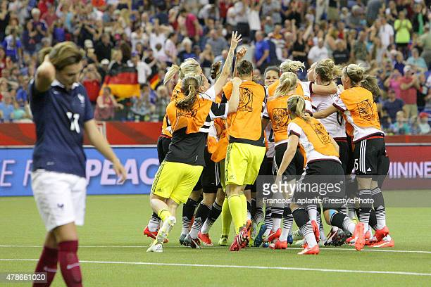 Team Germany celebrates their victory over France during the FIFA Women's World Cup Canada 2015 quarter final match between Germany and France at...