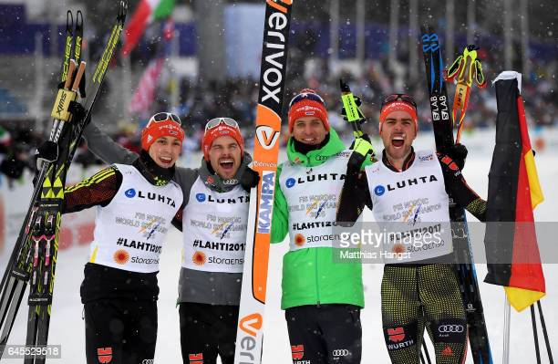 Team Germany Fabian Riessle Eric Frenzel Bjoern Kircheisen and Johannes Rydzek pose after winning the gold medal in the Men's Nordic Combined Team HS...