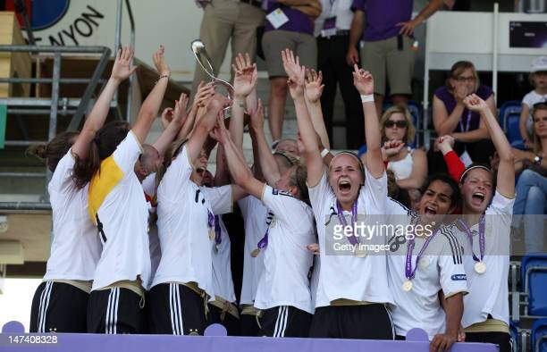 Team Germany lifts the trophy after winning the Women's U17 European Championship Final between France and Germany at the Colovray Stadium on June 29...