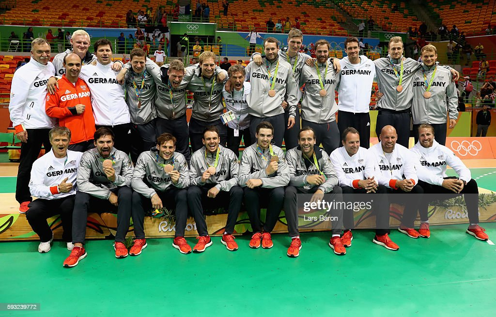 Team Germany poses on the podium during the medal ceremony for Men's Handball after winning the bronze medal on Day 16 of the Rio 2016 Olympic Games...