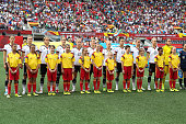 Team Germany stands with minor league soccer players prior to kickoff at the FIFA Women's World Cup Canada 2015 Group B match between Germany and...