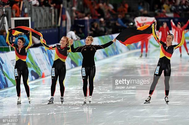 Team Germany with Daniela Anschutz Thoms Stephanie Beckert Anna FriesingerPostma and Katrin Mattscherodt celebrate the gold medal in the ladies' team...