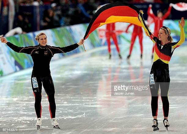 Team Germany's Stephanie Beckert and Anna FriesingerPostma celebrate the gold medal in the ladies' team pursuit finals on day 16 of the 2010...