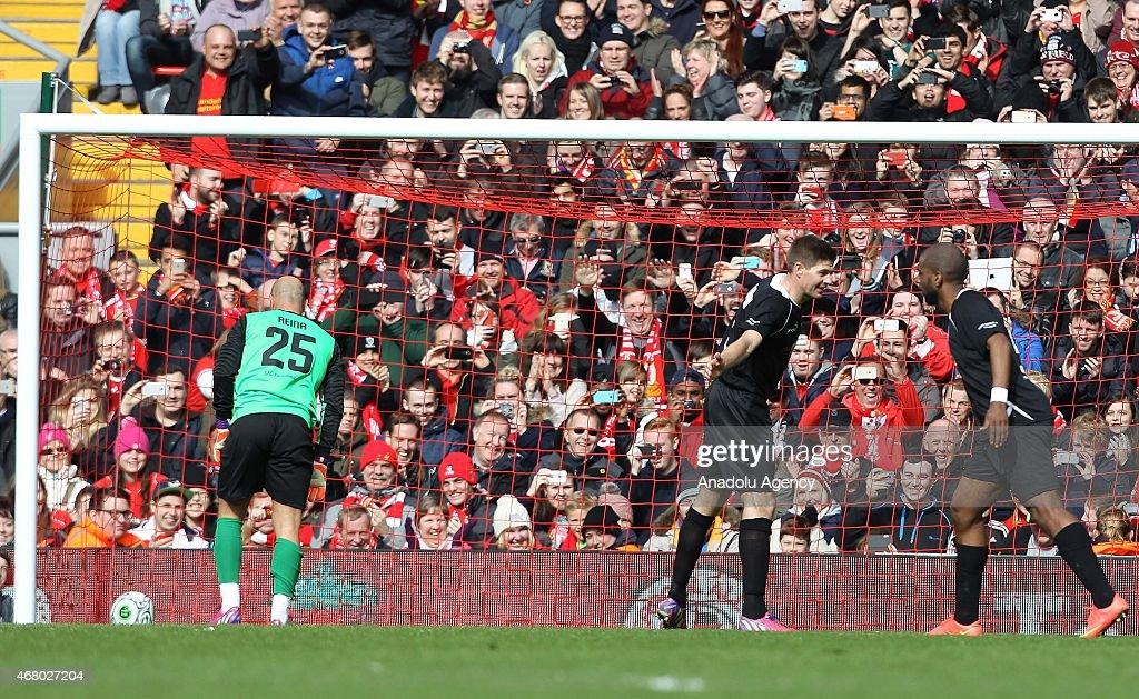 Team Gerrard Captain Steven Gerrard celebrates his penalty goal against Team Carragher with team mate Ryan Babel during the Liverpool AllStar charity...
