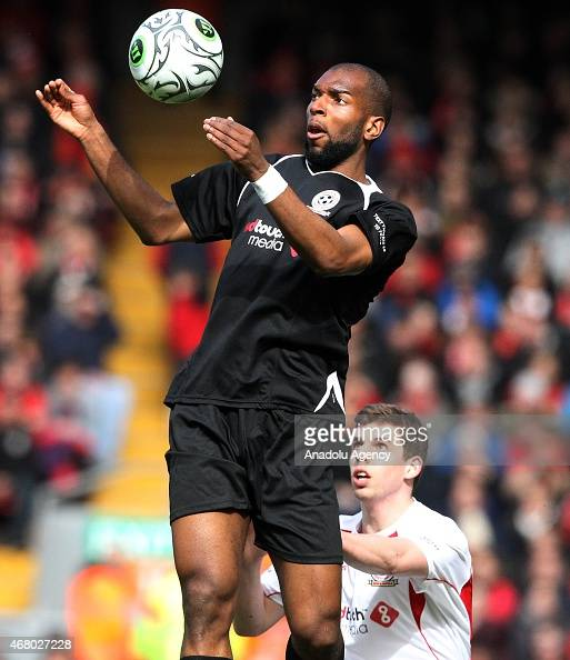 Team Gerrard's Ryan Babel vies with team Carragher's Jon Flanagan during the Liverpool AllStar charity soccer match at Anfield stadium in Liverpool...