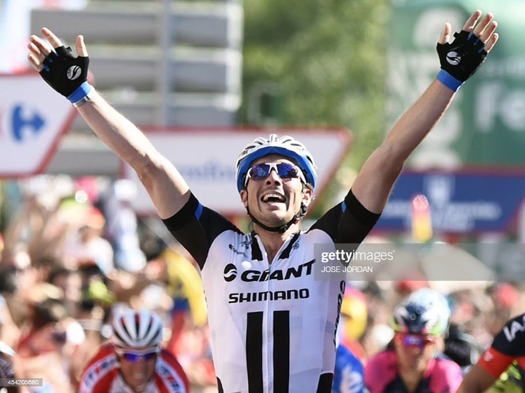 Team Giant -Shimano's German rider John Degenkolb celebrates as he crosses the finish line to win the 4th stage of the 69th edition of 'La Vuelta' Tour of Spain, a 164,7 km ride from Mairena del Alcor to Cordoba, on August 26, 2014.