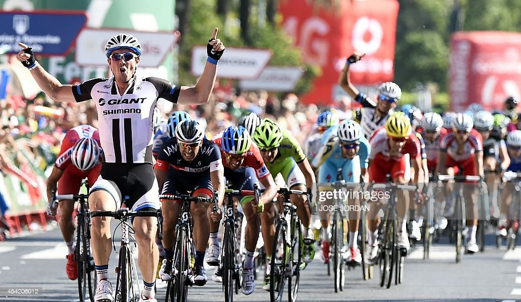 Team Giant -Shimano's German rider John Degenkolb (L) celebrates as he crosses the finish line to win the 4th stage of the 69th edition of 'La Vuelta' Tour of Spain, a 164,7 km ride from Mairena del Alcor to Cordoba, on August 26, 2014.