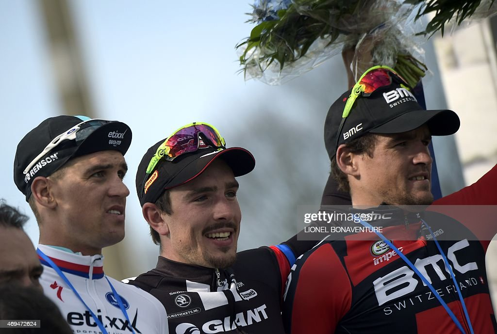 Team Giant-Alpecin German cyclist <a gi-track='captionPersonalityLinkClicked' href=/galleries/search?phrase=John+Degenkolb&family=editorial&specificpeople=5542317 ng-click='$event.stopPropagation()'>John Degenkolb</a> (C), Ettix-Quick-Step Team Czech cyclist Zdenek Stybar (L) and BMC Racing Team Belgian cyclist Greg Van Avermaet (R) celebrate on the podium after 113th edition of the Paris-Roubaix Paris-Roubaix one-day classic cycling race in Roubaix on April 12, 2015. Team Giant-Alpecin German cyclist <a gi-track='captionPersonalityLinkClicked' href=/galleries/search?phrase=John+Degenkolb&family=editorial&specificpeople=5542317 ng-click='$event.stopPropagation()'>John Degenkolb</a> won the race.