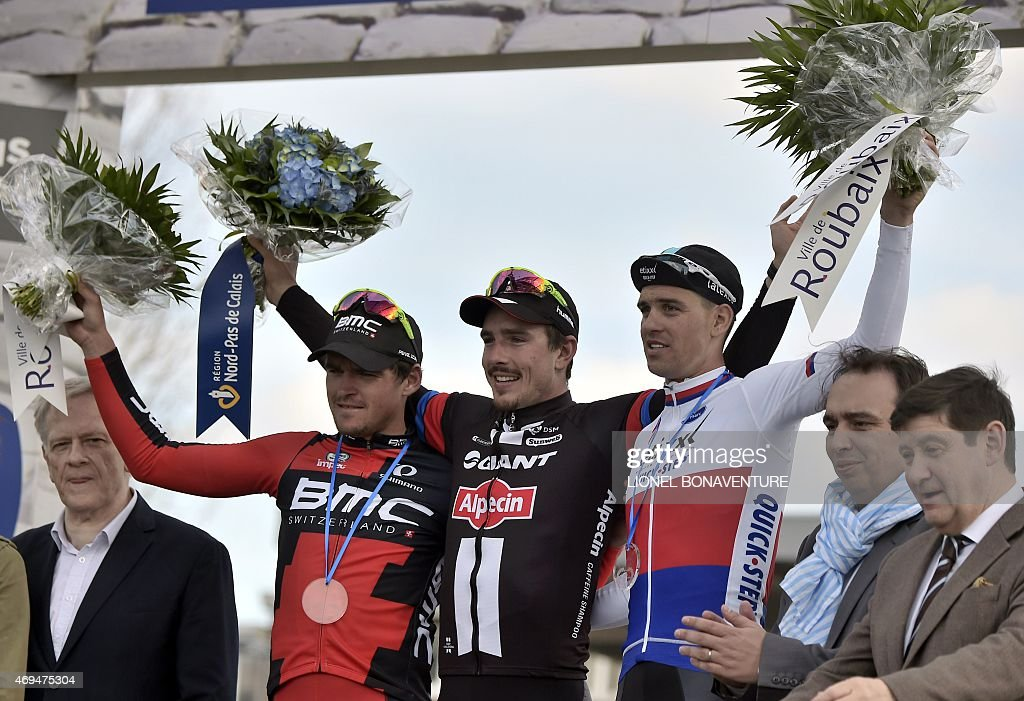 Team Giant-Alpecin German cyclist <a gi-track='captionPersonalityLinkClicked' href=/galleries/search?phrase=John+Degenkolb&family=editorial&specificpeople=5542317 ng-click='$event.stopPropagation()'>John Degenkolb</a> (C), Ettix-Quick-Step Team Czech cyclist Zdenek Stybar (R) and BMC Racing Team Belgian cyclist Greg Van Avermaet (L) celebrate on the podium after 113th edition of the Paris-Roubaix Paris-Roubaix one-day classic cycling race in Roubaix on April 12, 2015. Team Giant-Alpecin German cyclist <a gi-track='captionPersonalityLinkClicked' href=/galleries/search?phrase=John+Degenkolb&family=editorial&specificpeople=5542317 ng-click='$event.stopPropagation()'>John Degenkolb</a> won the race.
