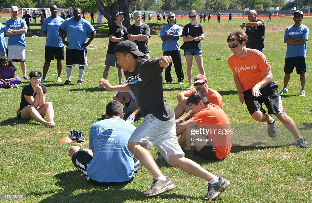 Team GoPro and Palantir members participate in the Duck Duck Goose game during the Founder Institute's Silicon Valley Sports League event on July 13, 2013 in Palo Alto, California.