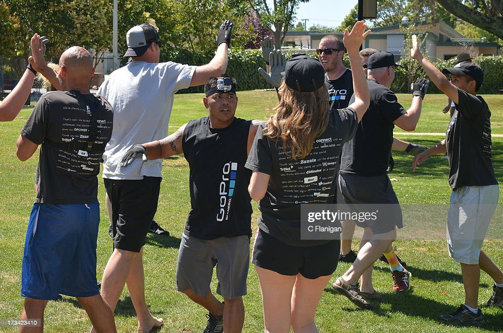 Team GoPro participates in the Tug-a-Rope competition during the Founder Institute's Silicon Valley Sports League event on July 13, 2013 in Palo Alto, California.