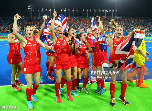 Team Great Britain celebrate after defeating Netherlands in the Women's Gold Medal Match on Day 14 of the Rio 2016 Olympic Games at the Olympic...