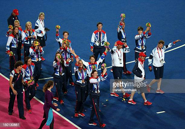 Team Great Britain celebrates with their bronze medals during the medal ceremony for the Women's Hockey on Day 14 of the London 2012 Olympic Games at...