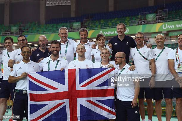 Team Great Britain coaching staff pose after the cycling medal ceremonies on Day 11 of the Rio 2016 Olympic Games at the Rio Olympic Velodrome on...