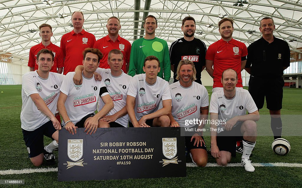 Team Grimshaw captain <a gi-track='captionPersonalityLinkClicked' href=/galleries/search?phrase=Nick+Grimshaw&family=editorial&specificpeople=4666727 ng-click='$event.stopPropagation()'>Nick Grimshaw</a> (front row, 2nd L), <a gi-track='captionPersonalityLinkClicked' href=/galleries/search?phrase=Robbie+Savage&family=editorial&specificpeople=169889 ng-click='$event.stopPropagation()'>Robbie Savage</a> (front row, 2nd R) and team-mates line up with Team Murs captain <a gi-track='captionPersonalityLinkClicked' href=/galleries/search?phrase=Olly+Murs&family=editorial&specificpeople=6350751 ng-click='$event.stopPropagation()'>Olly Murs</a> (2nd R), David May (back row, 3rd L) and team-mates before the start of the BBC Radio 1 five-a-side football match between Team Grimshaw, captained by BBC Radio 1 DJ <a gi-track='captionPersonalityLinkClicked' href=/galleries/search?phrase=Nick+Grimshaw&family=editorial&specificpeople=4666727 ng-click='$event.stopPropagation()'>Nick Grimshaw</a> and Team Murs, captained by singer and FA150 ambassador <a gi-track='captionPersonalityLinkClicked' href=/galleries/search?phrase=Olly+Murs&family=editorial&specificpeople=6350751 ng-click='$event.stopPropagation()'>Olly Murs</a>, at St Georges Park on July 29, 2013 in Burton-upon-Trent, England. In the build-up to Sir Bobby Robson National Football Day on August 10, the 5-a-side match was one of many events taking place around the country to mark The FA's 150th anniversary.
