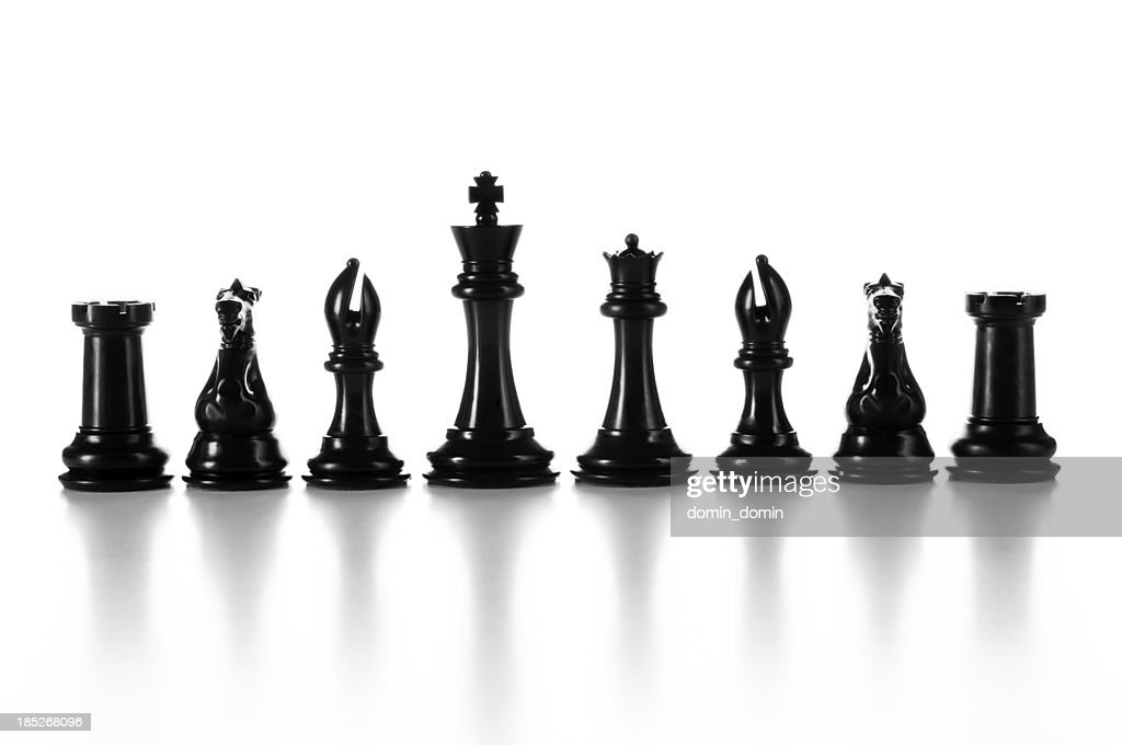 'Team, group of black chess pieces in a raw isolated'