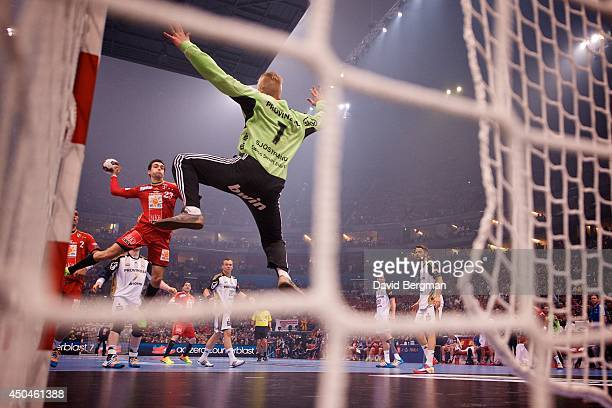 EHF Final Four MKBMVM Veszprem Cristina Ugalde Garcia in action scoring goal on shot vs THW Kiel goalie Johan Sjostrand during Men's Semifinals at...