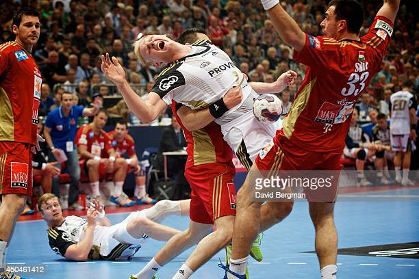 EHF Final Four THW Kiel Patrick Wiencek in action being fouled vs MKBMVM Veszprem during Men's Semifinals at Lanxess Arena European Handball...