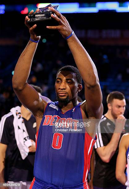 Team Hill's Andre Drummond of the Detroit Pistons celebrates with the trophy after defeated Team Webber during the BBVA Compass Rising Stars...