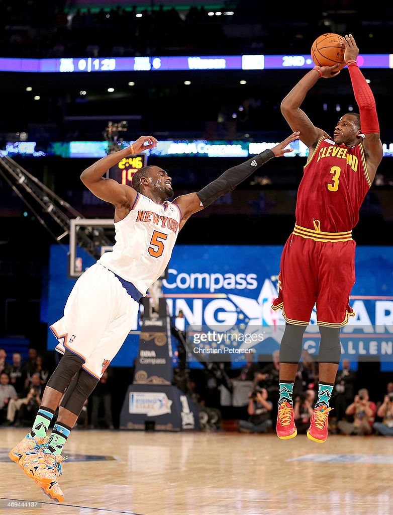 Team Hill's <a gi-track='captionPersonalityLinkClicked' href=/galleries/search?phrase=Dion+Waiters&family=editorial&specificpeople=6902921 ng-click='$event.stopPropagation()'>Dion Waiters</a> #3 of the Cleveland Cavaliers takes a shot as Team Webber's <a gi-track='captionPersonalityLinkClicked' href=/galleries/search?phrase=Tim+Hardaway+Jr.&family=editorial&specificpeople=7481128 ng-click='$event.stopPropagation()'>Tim Hardaway Jr.</a> #5 of the New York Knicks defends during the BBVA Compass Rising Stars Challenge 2014 as part of the 2014 NBA Allstar Weekend at the Smoothie King Center on February 14, 2014 in New Orleans, Louisiana.