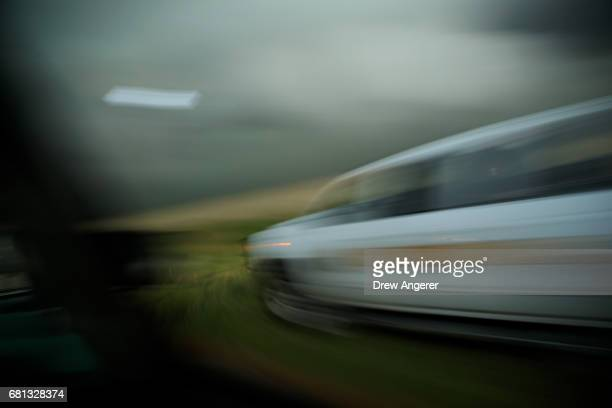 A team in a tornado scout vehicles passes a sheriff truck as they chase a supercell thunderstorm during a tornado research mission May 9 2017 in Lamb...
