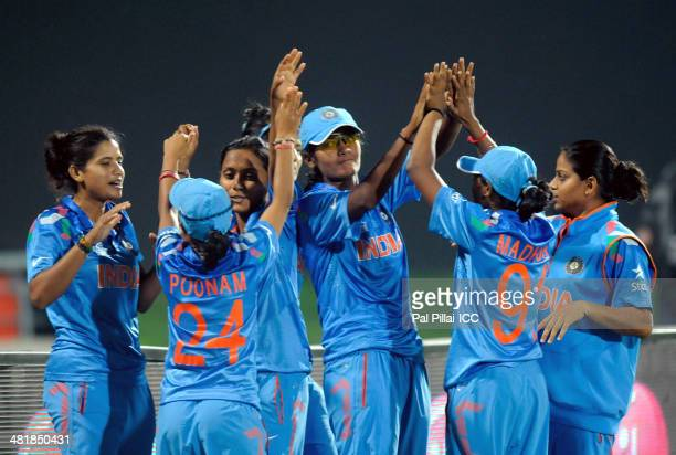 Team India celebrates after winning the ICC Women's World Twenty20 match between West Indies Women and India Women played at Sylhet International...