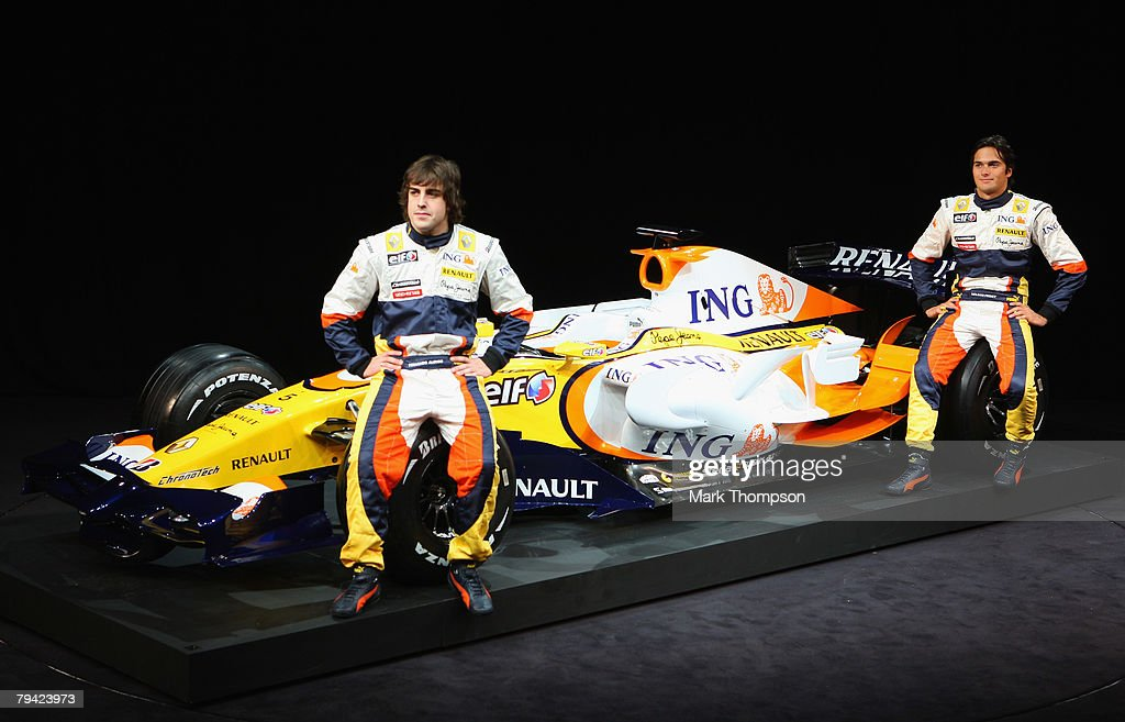 Team ING Renault drivers Fernando Alonso of Spain and Nelson Piquet of Brazil pose with the new Renault R28 Formula 1 car in Renault Square on...