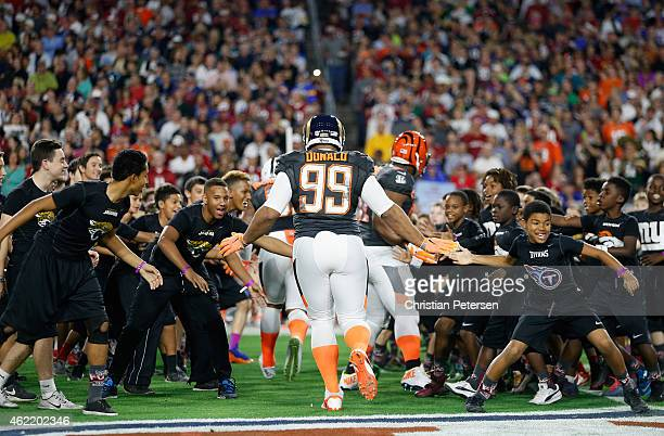 Team Irvin defensive tackle Aaron Donald of the St Louis Rams highfives kids before the start of the 2015 Pro Bowl at University of Phoenix Stadium...