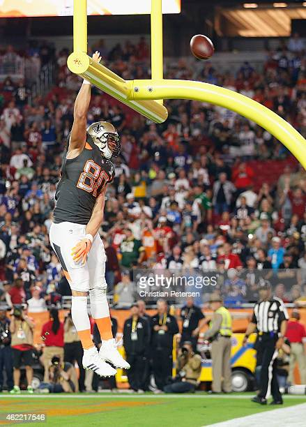 Team Irvin tight end Jimmy Graham of the New Orleans Saints celebrates a fourth quarter touchdown during the 2015 Pro Bowl at University of Phoenix...