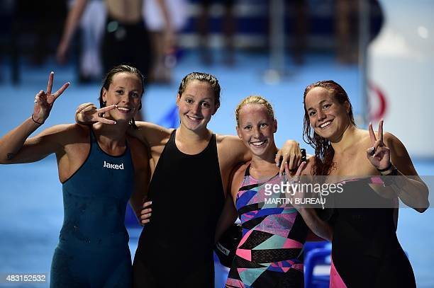 Team Italy celebrates the second place at the end of the final of the women's 4x200m freestyle relay swimming event at the 2015 FINA World...