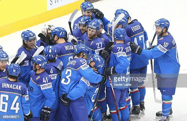 Team Italy celebrates the victory during the 2014 IIHF World Championship between Italy and France at Chizhovka arena on May 11 2014 in Minsk Belarus