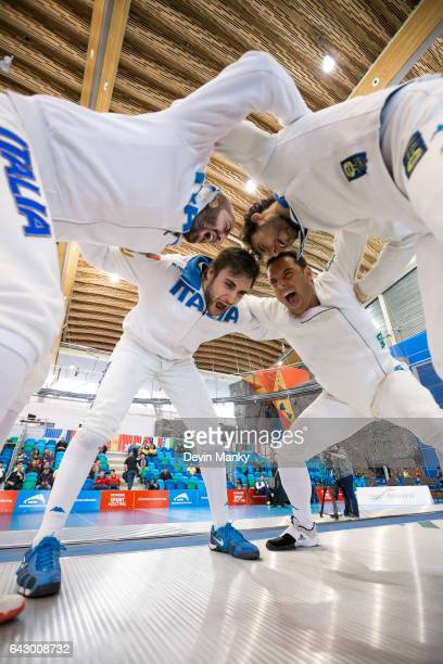 Team Italy's Marco Fichera Enrico Garozzo Paolo Pizzo Andrea Santarelli huddle together before the start of a match during team competition at the...