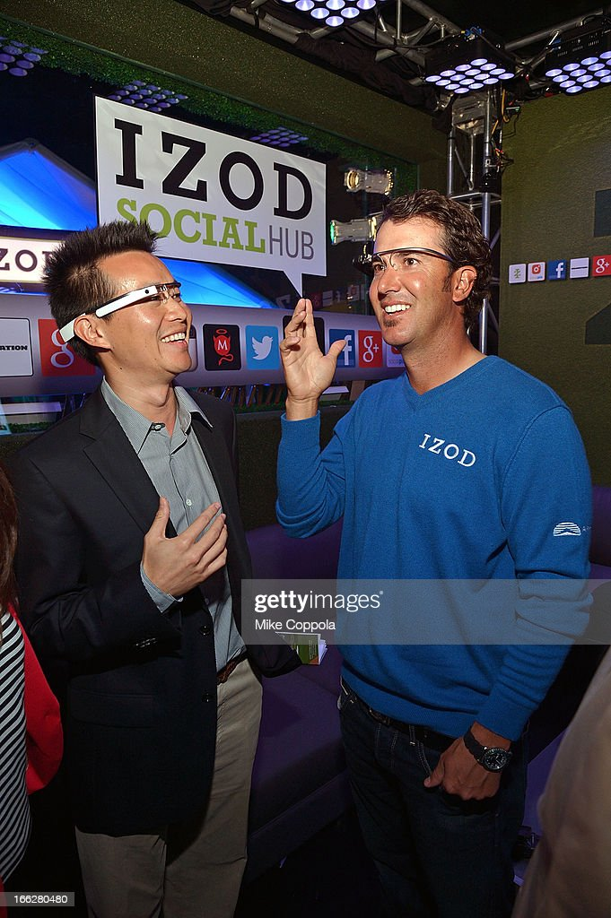 Team IZOD golfer and two-time PGA TOUR winner, <a gi-track='captionPersonalityLinkClicked' href=/galleries/search?phrase=Scott+Piercy&family=editorial&specificpeople=4464716 ng-click='$event.stopPropagation()'>Scott Piercy</a> (R) tries on google glass at the IZOD Social Hub at the MAXIM Clubhouse on Wednesday, April 10, 2013. on April 10, 2013 in Augusta, Georgia.