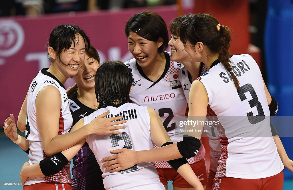 Team Japan celebrate after winning a point against Brazil during the FIVB World Grand Prix Final group one match between Brazil and Japan on August 24, 2014 in Tokyo, Japan.