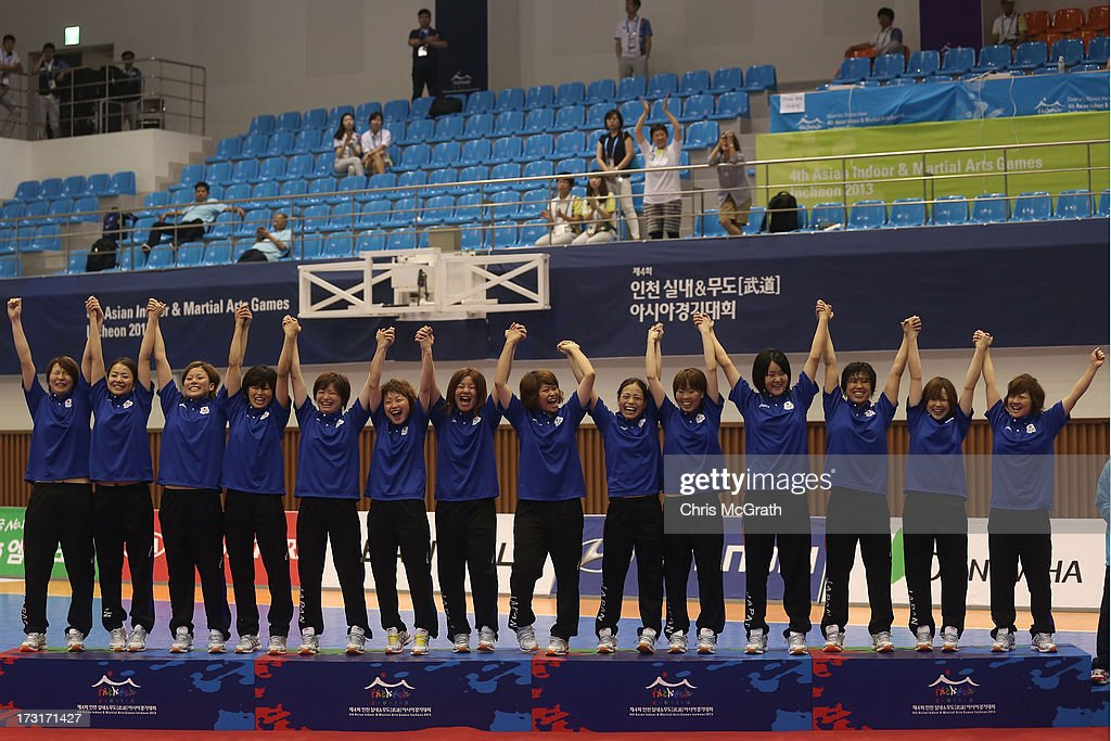 Team Japan celebrate victory on the podium after defeating Iran during the Women's Futsal Gold Medal match at Songdo Global University Campus Gymnasium during day seven of the 4th Asian Indoor & Martial Arts Games on July 5, 2013 in Incheon, South Korea.